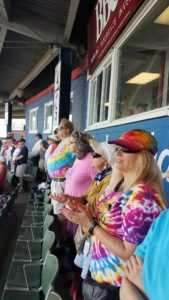 Greater Berks Chapter members standing at their stadium seats at Reading Fighting Phils game.