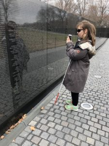 Angelina feeling the names engraved on the Vietnam war memorial