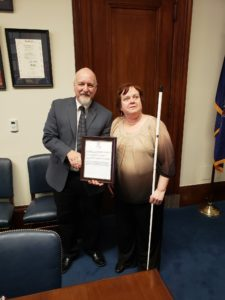 Lynn Heitz presenting Michael Gamel McCormick with a framed copy of the resolution passed at state convention for Senator Casey.